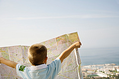 boy-reading-city-map-at-resort-s_105