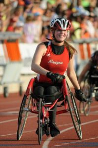 Abby Dunkin smiling after finishing first in the 400m at the Texas State Championship. Photo Credit: reporternews.com