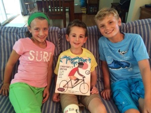 Caitlin, Rio and Nolan showing off the personalize copy of Emmanuel's Dream by Laurie Thompson. One person can change the world.