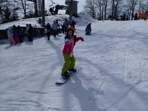 Emilia snowboarding at Wintergreen Resort. Photo Credit: G. Scovel