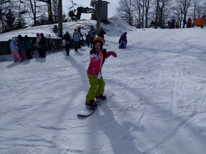 Emilia snowboarding at Wintergreen Resort. Photo Credit: G. Scovel