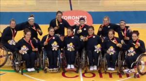 Team USA Women's Wheelchair Basketball showing off their gold medals at the 2015 Parapan Games in Toronto. Photo Credit: NWBA (@NWBA) twitter.com