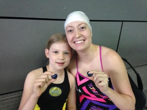 Emilia and Cortney at a swim meet together. Photo Credit: G. Scovel