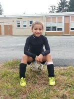 Emersynn ready to play soccer. Photo Credit: Thomas Cage