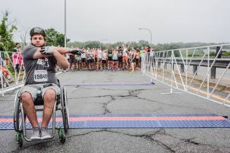 Zack preparing for 10 mile road race in Rhode Island. Photo Credit: Rhode Race