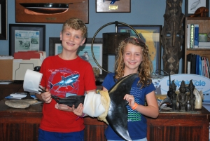 Nolan and Caitlin holding Winter's newest tail. Photo Credit: Jen Stratton